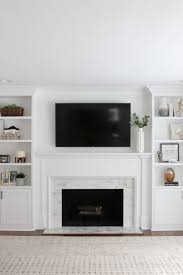DIY Playbook Putting White Marble Tile On A Fireplace