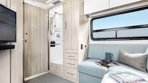 Unity motorhome combines murphy bed and swivel recliners in comfy, flexible lounge. 2020 Mercedes Unity Model Leisure Travel Vans Campervan Murphy Bed