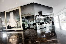chandeliers and a mirrored reception desk add a touch of glitz