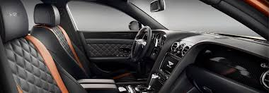 bentley flying spur w12 s front cabin with black and orange quilted seats bentley motors
