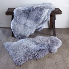 deep pile light grey new zealand sheepskin rug shown in single or double