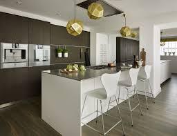 High end contemporary kitchen - White kitchen island with Stainless Steel  worktop. Dark oak was