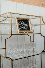 all white courtyard garden wedding bar inspiration als white glove als ft camba gold etagere photography victoria selman