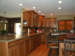 Kraftmaid Hickory Belmont With Sunset Stain Kitchens Baths By Greta