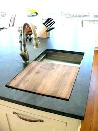 kitchen sinks with cutting board kitchen sink with cutting board and strainer sink cutting board kitchen