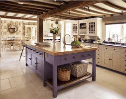 purple rustic kitchen island with butcher block countertop in a classic white kichen
