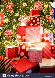 Lighted Stacked Christmas Gift Boxes Stacked Gift Boxes By Illuminated Christmas Tree Stock Photo