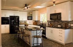 white cabinets in kitchen with black appliances. How to decorate using  countertop and backsplash with