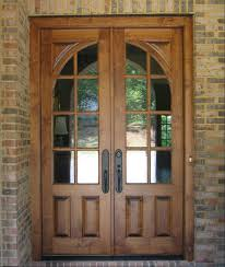 oak wood double french doors exterior with glass insert and metal handle for rustic house design with exposed brick wall ideas