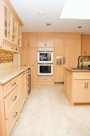 Light Maple Cabinets Stainless Steel Appliances Tan And Brown Tile