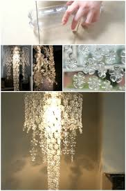 cut off the bottom part of a plastic bottle and what do you see a perfect flower design this chandelier is very easy to make all you need to do is string