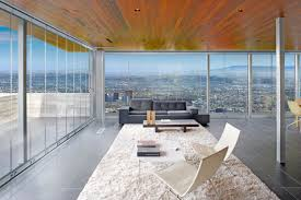 new frameless sliding glass doors protect homes from the elements