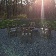 diy pea stone patio with a built in stone firepit