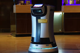 directly adjacent to the las vegas convention center is a renaissance hotel with a pair of special staff members robots