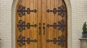 glasscraft door company introduces premium wrought iron door straps and clavos