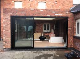 black smart architectural aluminium triple track sliding patio door with black hardware to match installed
