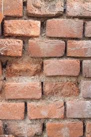 old brick wall weather impact