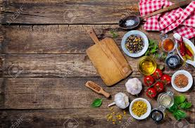 cutting board with food. Ingredients For Cooking And Empty Cutting Board On An Old Wooden Table. Food Background With