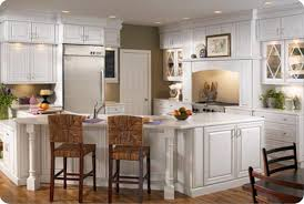 White Kitchen Laminate Flooring White Wooden Pantry Cabinet And Kitchen Island With Brown Rattan