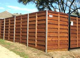 build wood fence building wood fence can you build a wooden with metal posts on uneven