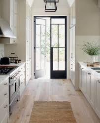 Apartment or Galley white kitchen with blonde wood floors! Dark ...