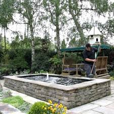 build this simple above ground pond ideas in a weekend it features fountain and trellis fish above ground goldfish pond fish designs ideas