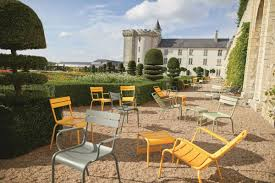 Luxembourg aluminium outdoor chairs in french chateau courtyard