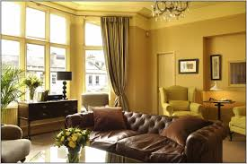 Yellow Wall Living Room Decor This Guest Room Wall Color Dark Green And Light Curtains Sofa