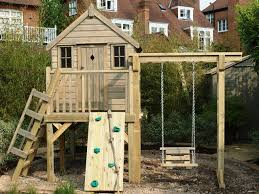 treehouses with swing seat and climbing wall