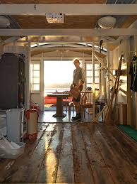 the blue carpet on the walls is for insulation bill also built a gangplank for clambering down to the beach and invented his own text message device to