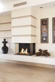 three sided fireplaces offer tradition with a twist