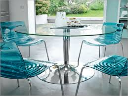 round glass dining table with chrome pedestal base plus blue glass