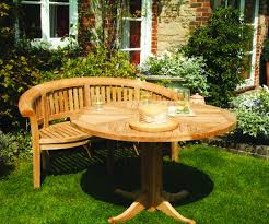 teak garden table and folding chairs