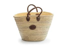 a medium sized palm shaped basket with a thick short leather handles 35cm this basket is approximately 32cm high 28cm long at the base and 50cm across