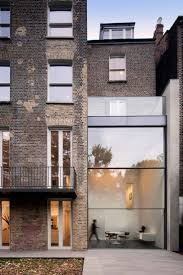 House on Bassett Road designed by Paul+O Architects, glass rear facade in  brick