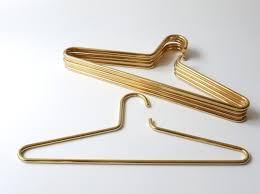 Vintage solid brass coat hangers by the famed Austrian modernist, Carl  Aubock. On sale