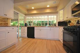 tile flooring that looks like wood Kitchen Traditional with black