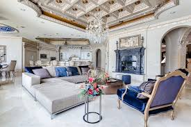 luxury living room with elegant chandelier and custom box ceiling