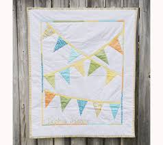 Twelve Beautiful Handmade Quilts For Baby's Nursery | Disney Baby & Bunting Flags Quilt Adamdwight.com