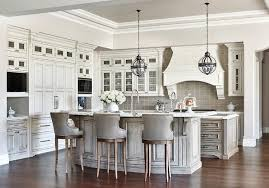 Glamorous, Well Appointed Kitchen Features Restoration Hardware Victorian  Hotel Pendants Hung From A Light Gray Tray Ceiling Over A Curved Gray Wash  ...