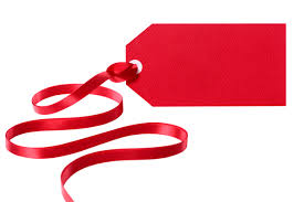 Red tag with a red ribbon Photo | Free Download