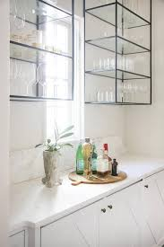 butlers pantry with wall mount iron and glass shelving unit