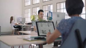 Trendy office Startup Trendy Open Plan Office Workplace People At Computers Work Stations Coworking Shared Space Boca Newspaper Trendy Open Plan Office Workplace Stock Footage Video 100 Royalty
