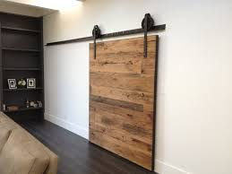 the door is custom made from solid reclaimed cky tennessee barn siding