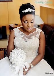 bride with white wedding bouquet nigerian wedding dresses 5