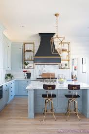 Blue Kitchen with Brass accents. A black French kitchen hood ...
