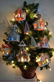 Nifty idea ...house ornaments that are made out of old Christmas cards.