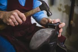 a cobbler fixing a shoe