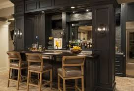 Traditional Bar with Brick floors, Built-in bookshelf, Wall sconce, High  ceiling