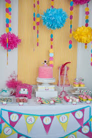 Decorations:Cute And Playful Decoration Of Small Table For Birthday Cake  And Colorful Hanging Art